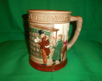 One (1), Royal Doulton, Oliver Twist Tankard, Copyrite 1949