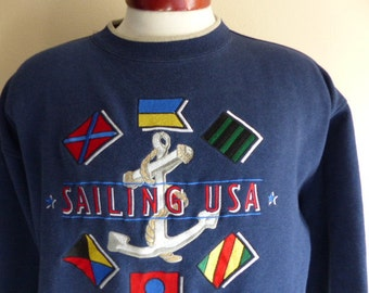 vintage 90's Sailing USA nautical flags anchor embroidered logo graphic sweatshirt unisex beige stripe crew neck navy blue fleece pullover