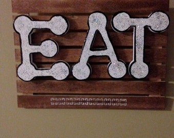 eat wood wall hanging