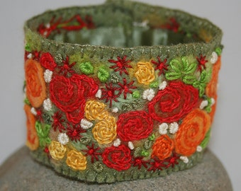 Embroidered Cuff - Red and Orange Rose border Felted and stitched by Lynwoodcrafts