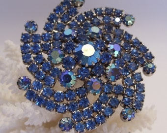 Aurora Borealis and Blue Rhinestone Pinwheel Brooch