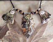 Organic, rustic, earth toned birch bark statement necklace with silver wire and beads strung on a leather cord