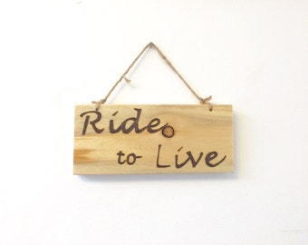 Ride to live wood burned sign