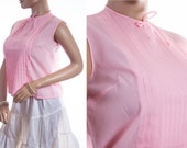 Really sweet authentic 1950's vintage sheer candy pink nylon pleat front design button back detail sleeveless bow trimmed blouse - DB182