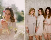 Veil of Mist. 4 knee length robes in faux crepe de chine silk trimmed with lace. Bridal robes and bridesmaids robes in neutral tones.