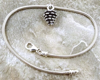 Sterling Silver Pine Cone Charm on a Sterling Silver Slim European Charm Bracelet - (3482/tube)