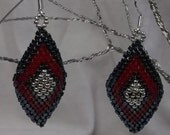 "Native American style Brick Stitch Earrings, using Black, Red and Silver Miyuki Seed Beads.  1 1/2"" long by 3/4"" wide"