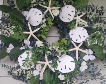 Eucalyptus starfish, sand dollar wreath. Made by a stay at home veteran.