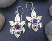 Purple amethyst earrings, fluer de lis design, mixed metals, solid sterling silver with areas of brass overlay, unique artisan metalwork
