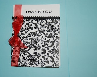Homemade Letterpress Thank You notes, set of 5,black and white damask bottom with ribbon across top and ribbon on side with bow.