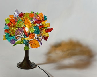 Table lamp Decor with multicolored flowers a leaves and metal wires, lighter for desk or bedside table.