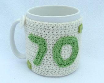 70th Birthday cream crochet mug cozy with green applique numbers