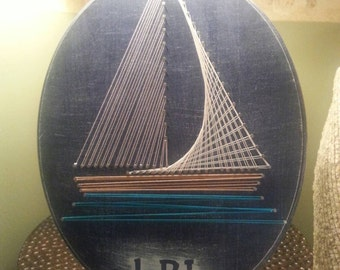 """Personalized LBI Rustic Navy Blue Sailboat String Art on 11x14"""" Oval Plaque"""