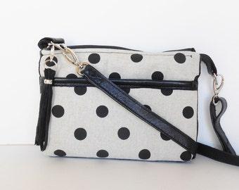 Crossbody bag, or shoulder bag, sling bag,with polka dots and leather trim.
