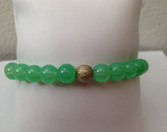 Light Green Glass Bead Bracelet accented with gold stardust