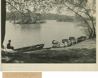 Lonely man by lake boat landing antique art photo by William C. Wright