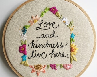 Hand embroidered love and kindness art hoop