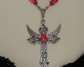 Gothic red and silver winged cross
