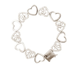 Sterling Silver Sweet 16 Dancing Hearts Bracelet (Free Shipping)