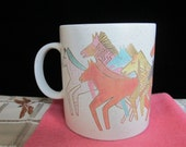 Laurel Burch Native Horses Signed Coffee Mug Southwest Design Speckled Pastel Colors Gold Accents Brown Yellow Orange Pink Turquoise 1990