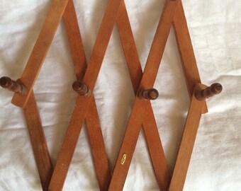 "Smaller wooden peg or accordion rack 13.25"" reddish tone"