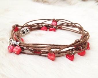 Coral wrap bracelet.  Coral chip beads on brown cord silver plated bracelet. Gemstone bracelet. Coral jewellery.