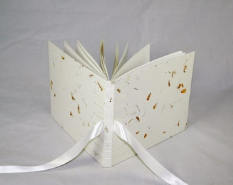Unique Guestbook with handmade off white paper with orange flowers  in Secret Belgian Binding with off-white/ ivory satin tapes
