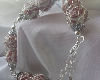 French knit wire bracelet with porcelain beads