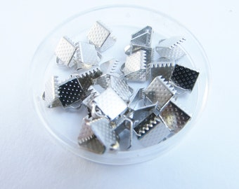 D-02072 - 50 Ribbon ends nickel color 8x6mm