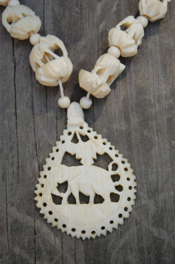 Vintage carved faux ivory elephant necklace with elephant
