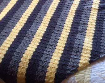 Crocheted lap afghan in yellows, greys and dark greys