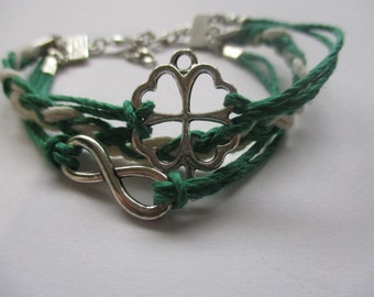 Handmade Irish Bracelet With Four Leaf Clover and Infinity Symbol on Green and White Hemp