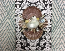Journal book embellished with natural seashells.Black and white  scroll design.