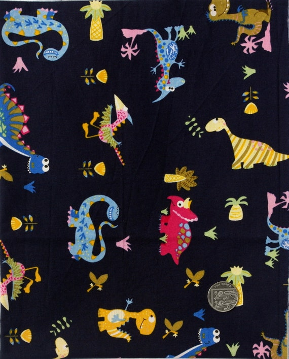 Fabric children 39 s novelty fabric dinosaur print on navy for Kids novelty fabric