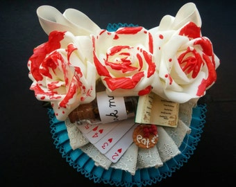 Alice in Wonderland inspired fascinator. Complete with painted roses, cards, and more!