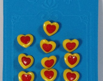 10 Buttons in plastic red and yellow hearts 15 mm with hook.