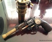 One of a kind handmade steampunk laser pistol with thread on buffer recycled solid metal parts