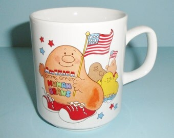 1981 America Grows Great Human Beans Ceramic Mug With USA Flags