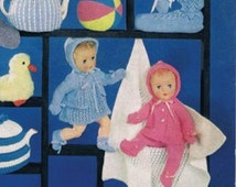 """A vintage knitting pattern to knit Layette & outfits for 14"""" , 16"""" and 18 """" dolls. Using 3 ply,4ply and 8 ply wool. From the 1960's"""