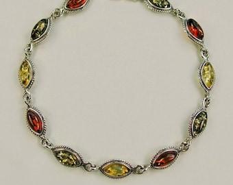 Genuine Baltic amber oxidized sterling silver bracelet .