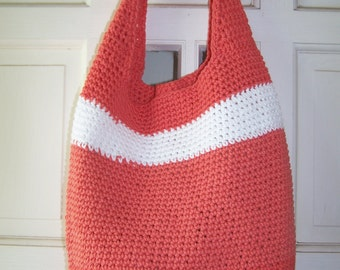 Hand crocheted bag in a papaya color all cotton yarn