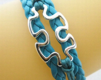Quality Turquoise Leather Braided Autism Puzzle Piece Bracelet