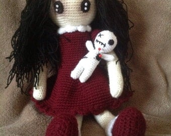 Little goth girl with her voodoo teddy