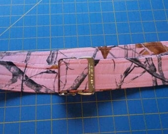 Custom wrapped gait belt with metal buckle in your chosen fabric. Shown in photo is pink camo