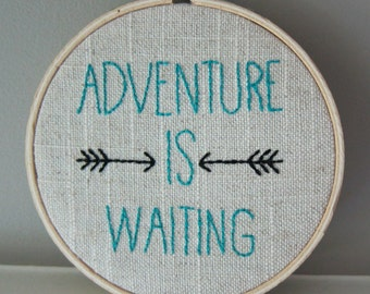 "Hand-Embroidered 4"" Hoop Wall Art with Turquoise ""Adventure is Waiting"" Quote Saying with Arrows on Tan/White Linen"