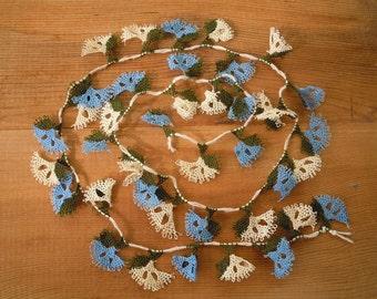 needle lace fanshapes, blue white, 40 pieces