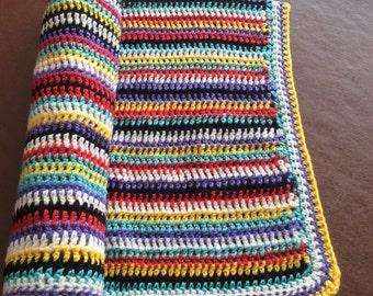 Brightly coloured crocheted baby/pram blanket
