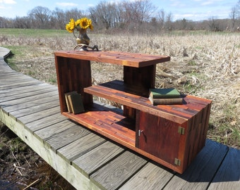 Staggard rustic reclaimed wood console table/ entertainment center.