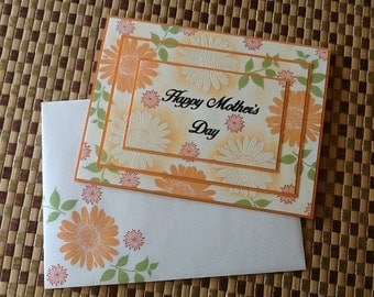 Handmade Greeting Card:  Mother's Day Card. White embossed and mango flowers