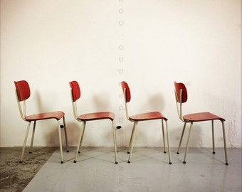 Set of 4 red chairs.